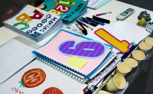 kindergarten-students-workbooks-on-teacher-table-P6GHVYH.jpg